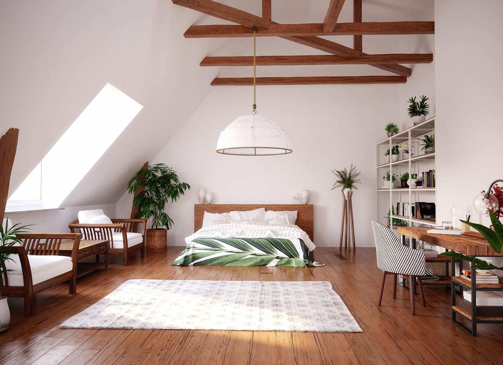 Charakterstark: Die freiliegenden Holzbalken im firsthohen Raum sorgen für eine besondere Atmosphäre.